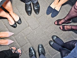 shoes of party people standing in a circle